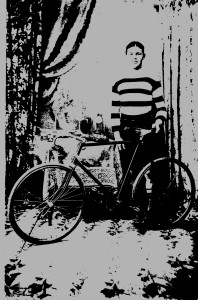Arthur Churchill with his bike and cycing trophies