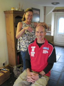 Sue cutting Norman's hair ready for the race
